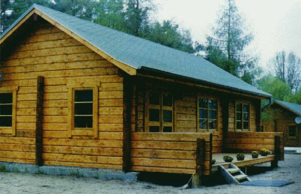 Machined log houses